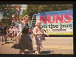 """Nuns on the Bus"" with Sister Simone Campbell waving"