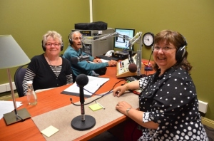 Elaine B. Holtz (L.) interviewing Julie Combs R.) with Ken Norton at the soundboard in Radio KBBF's new studio